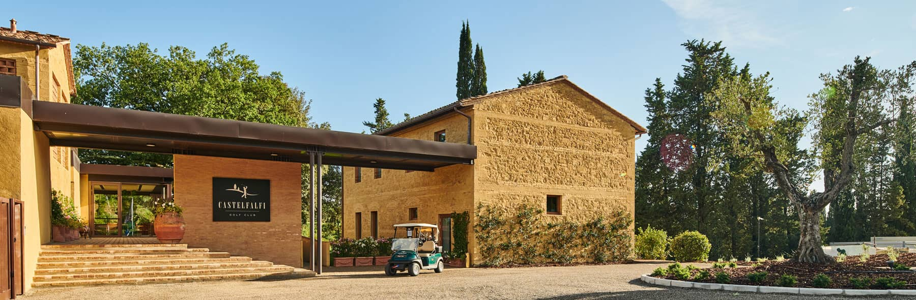Exterior view of the new Club House, restaurant and pro shop at Golf Club Castelfalfi, Tuscany, Italy